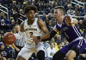 No. 19 Michigan overcomes slow start to beat Holy Cross