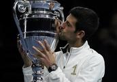 Djokovic brushes aside Isner at ATP Finals