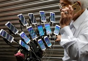 Array of iPhones and Android devices used on bike by Taiwan senior to play Pokemon Go