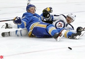 APTOPIX Jets Blues Hockey