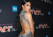 Kim Kardashian Unexpectedly Styles Her Leggy Glittery Dress With Sock Boots