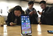 The Latest: Apple to appeal iPhone ruling in China