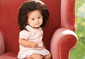 Baby girl with exceptionally long hair becomes Pantene model after her photos go viral