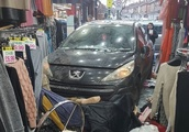 Horrific photos of smashed shop after car crash which worker 'missed by minutes'