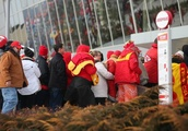 Fans at AFC title game do everything they can to keep warm at frigid Arrowhead Stadium