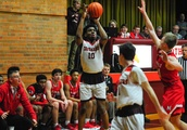 Board beast: Deandre Hagan's late 3-point play clinches Brother Rice's rivalry win over Marist