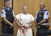 Smiling mosque massacre shooter makes a white supremacist sign with his hand as he is charged with m