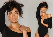 Nicole Scherzinger sets pulses racing as she poses in an off-the-shoulder bodysuit for a sexy photo