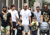 Football player Pierre-Emerick Aubameyang with his family shopping in Milan, at the exit of Philippe