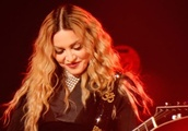 Madonna faces backlash for posting photos of her Black daughters with watermelon