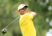 Tiger charges while Woodland fires 64 at storm-hit Medinah