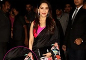 Guess The Price! Madhuri Dixit Nene's sleek Bvlgari clutch purse comes at a steep price