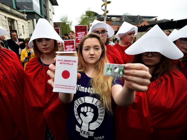Northern Irish women protesting anti-abortion laws take illegal termination pills in front of police