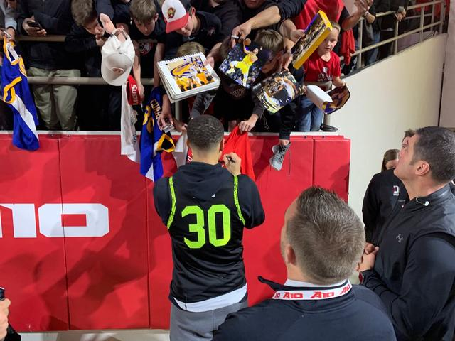 b43bf7878de Warriors  Stephen Curry jumps into student section to celebrate Davidson s  win Sports
