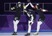 The Latest: US women advance in team pursuit speedskating