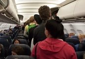 Shocking! Fight Breaks Out On Plane. Reason? Passenger Who Wouldn't Stop Farting!!