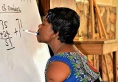 This Will Melt Your Heart - Photo Of Armless Ghanaian Lady Teaching Maths & Writing With Her Mou