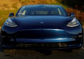 Tesla surprises with quarterly profit on record deliveries, shares up 21%