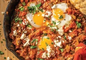 Shakshuka: This dish of poached eggs in spiced tomato sauce is said to have originated in Tunisia